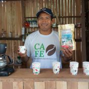 Cruz Juanan stands in his coffee shop in Peru