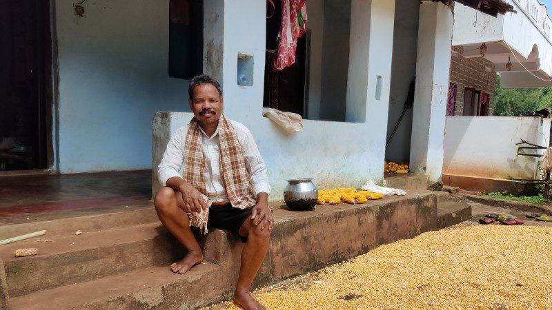 Mottadam Jogiraju sits in front of his home in India