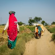 Women farmers in India walking down a path