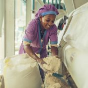 A woman worker at a grain mill in Sannie, Ethiopia