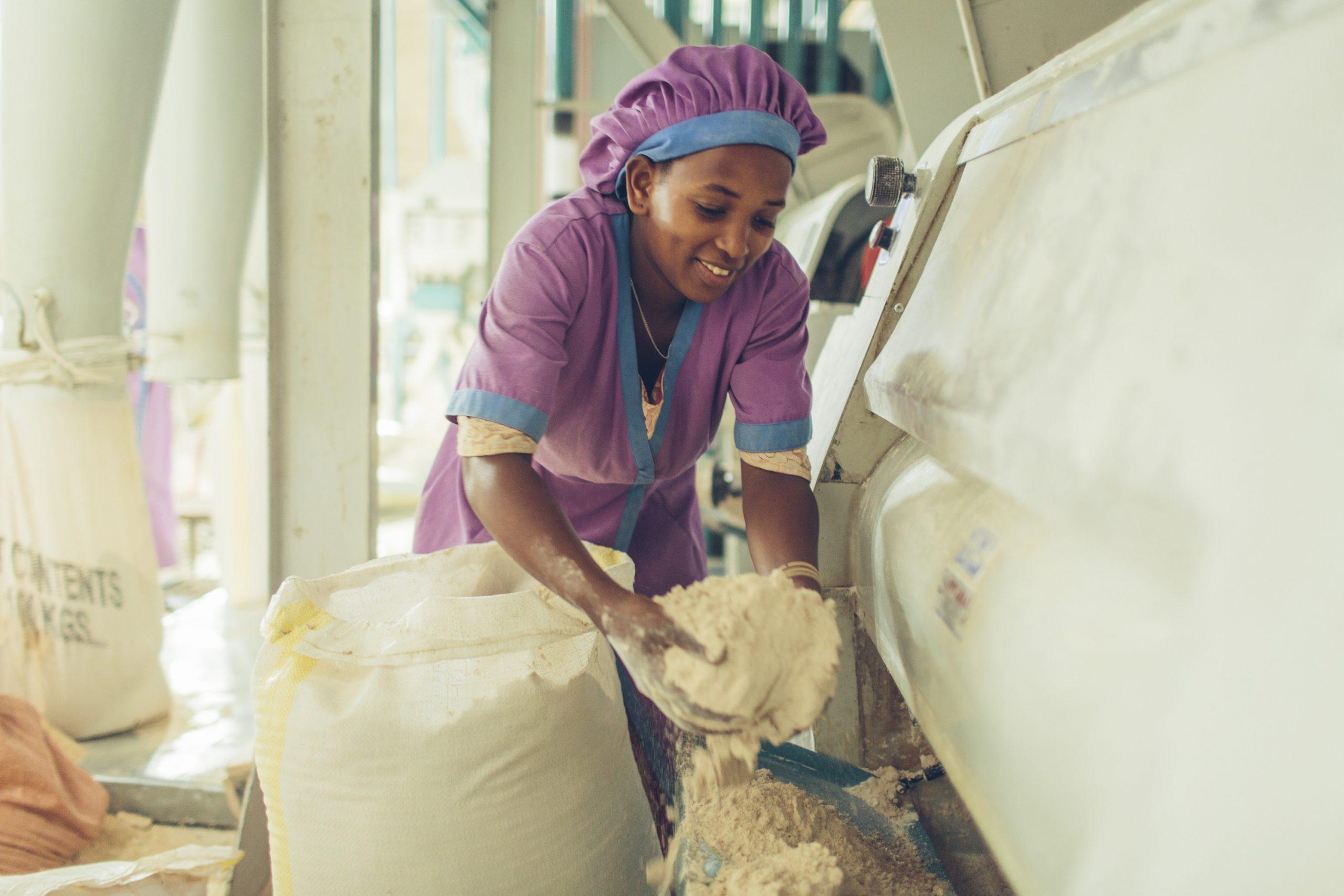 A woman worker at a grain mill in Sannie, Ethiopia