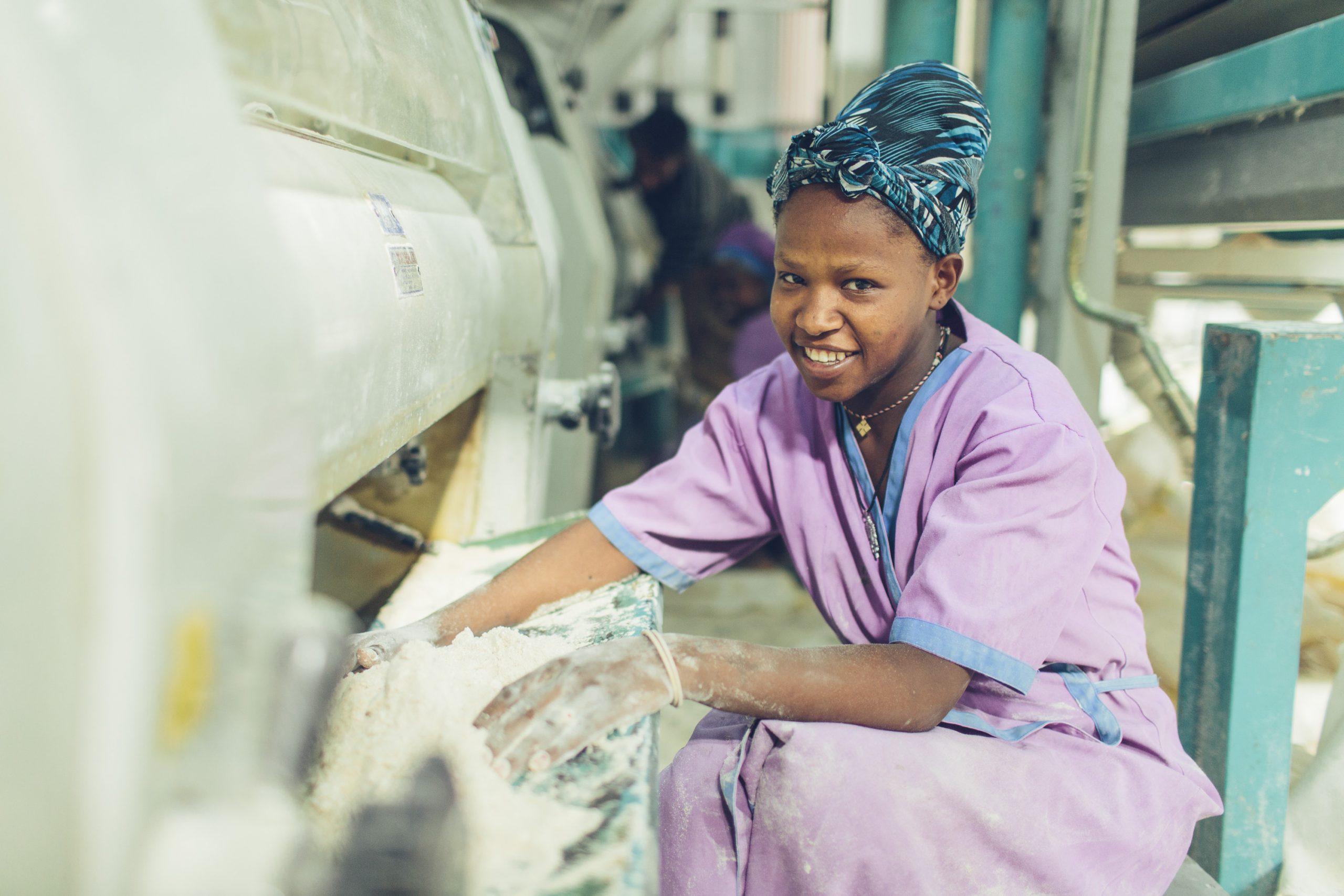 A woman working at a grain mill in Sannie, Ethiopia