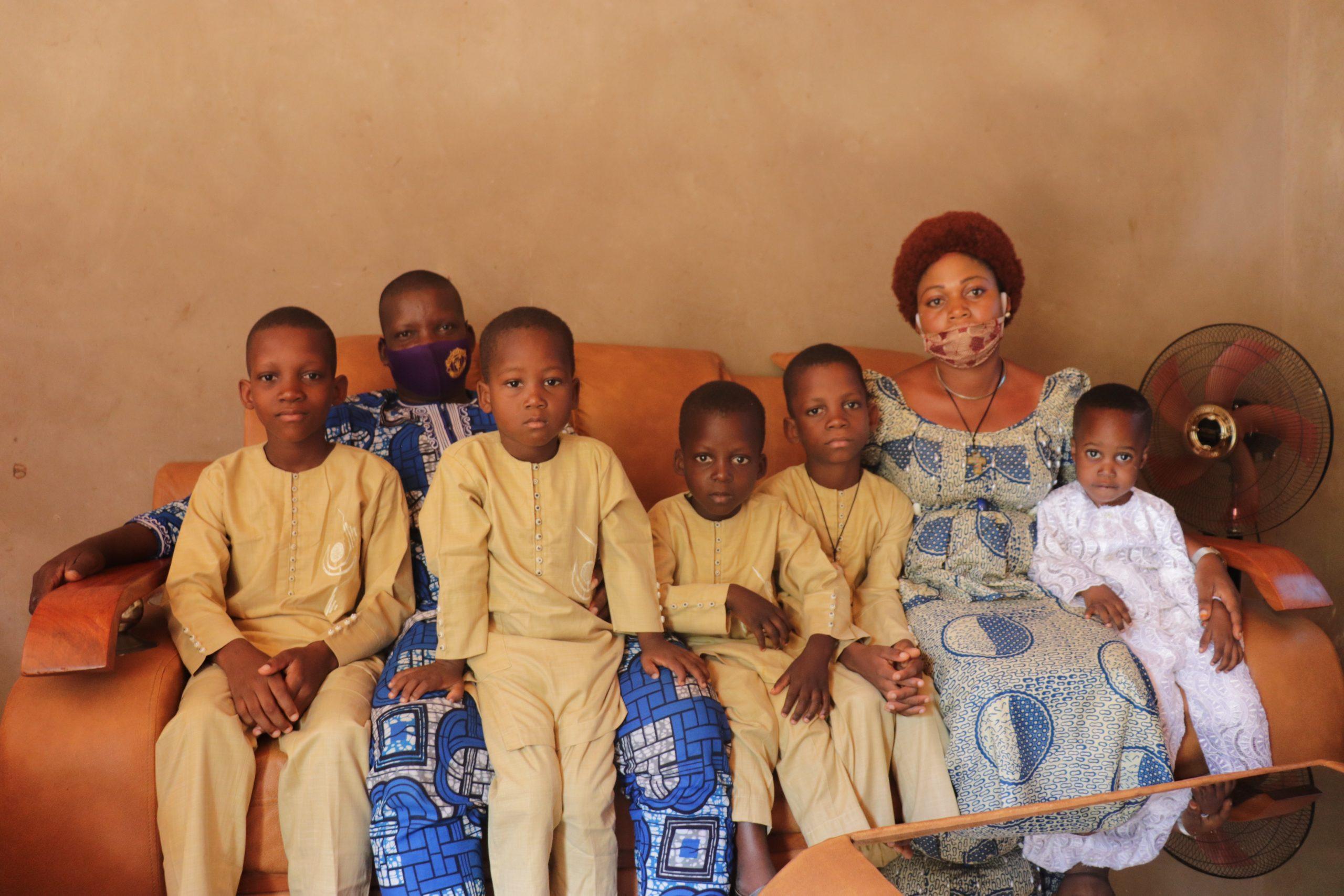 Entrepreneur Virginie Adounon with her family in Bohicon, Benin