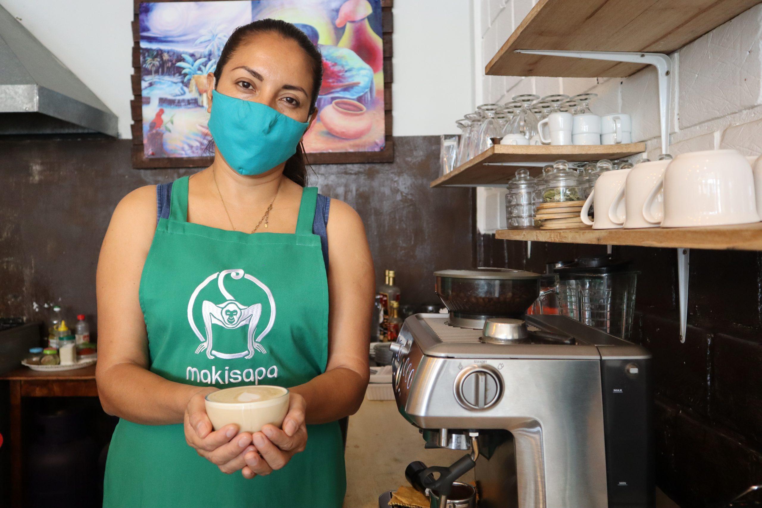Juliana Solis Baron stands in her coffee shop in Peru's San Martin region
