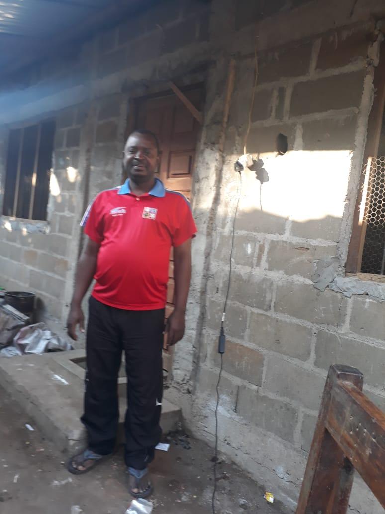 Amândio Cardoso stands outside his home in Pemba, Cabo Delgado, Mozambique.