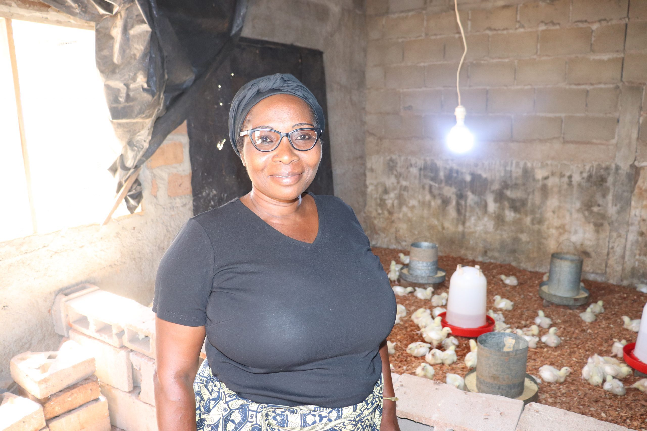 Helena Manura stands in her chicken coop in Cabo Delgado, Mozambique