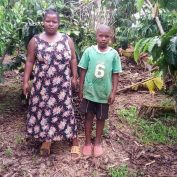 As Coffee farmers face the COVID-19 Crisis worldwide, Biringwa is no exception. Featured here, she stands with her son on their farm in Uganda