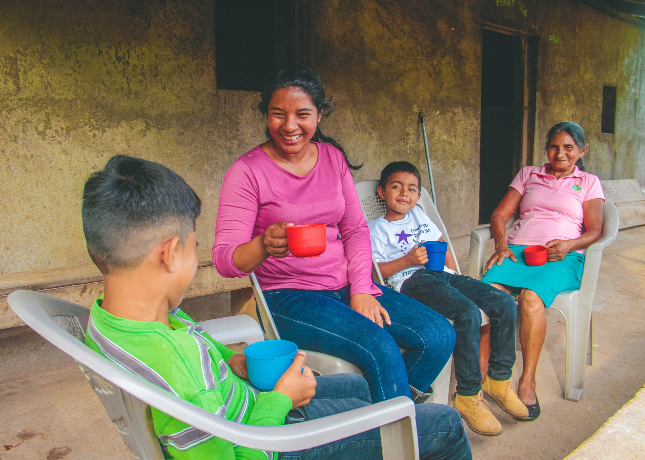 Rosa Gonzales with her son, nephew, and mother on their small farm in Nicaragua.