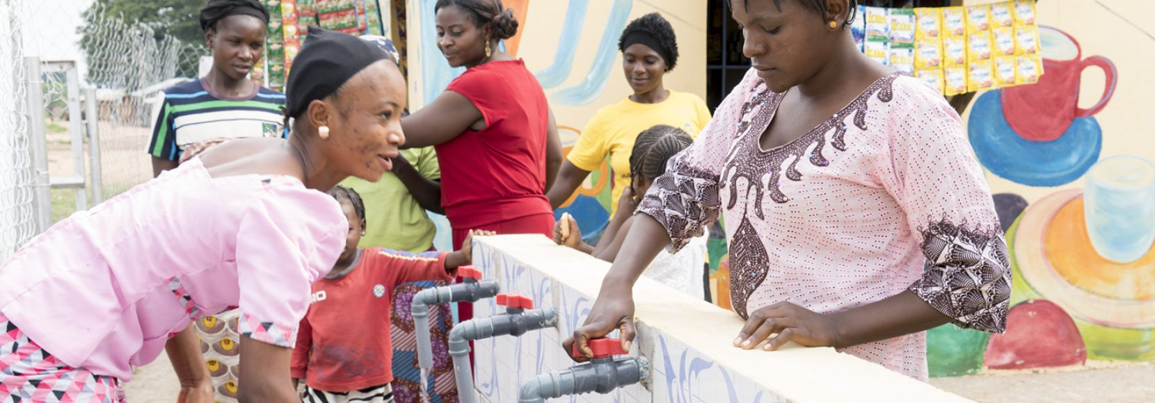 A group of women, all impacted by unpaid care work in their own way, gather water in Nigeria