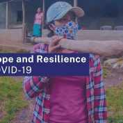 resilience and hope are keys to survival during COVID-19. hoto of woman in Nicaragua wearing a mask and walking with her son who is also wearing a mask. Text says