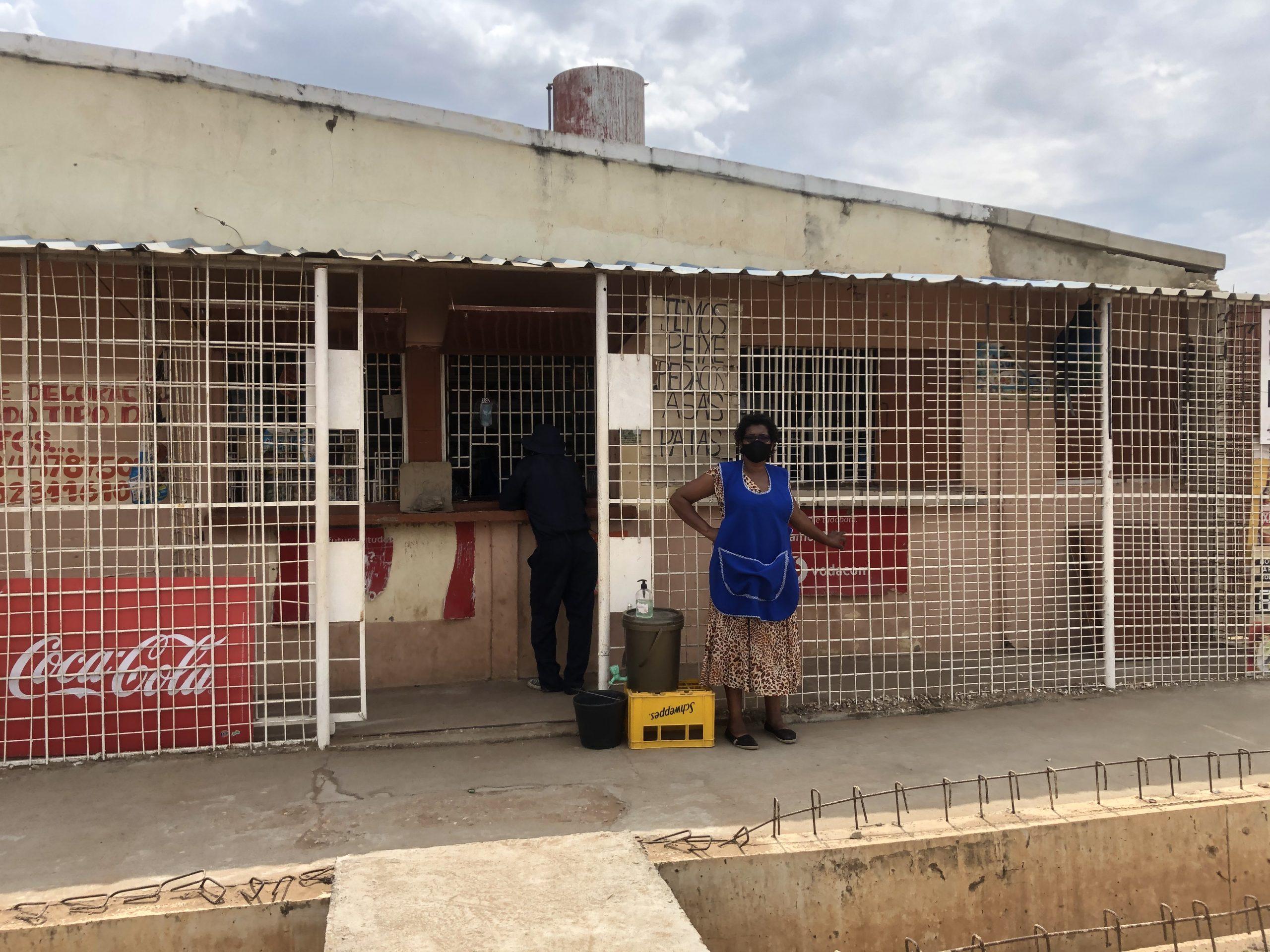 Rita Sitóe stands outside her shop near Maputo, Mozambique.