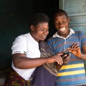 User personas lead to better tech solutions, such as the ones used in TechnoServe's program, Mobile Connected Farmer Alliance (CFA). M-Pawa user. Mbeya Region, Tanzania. September 2015.