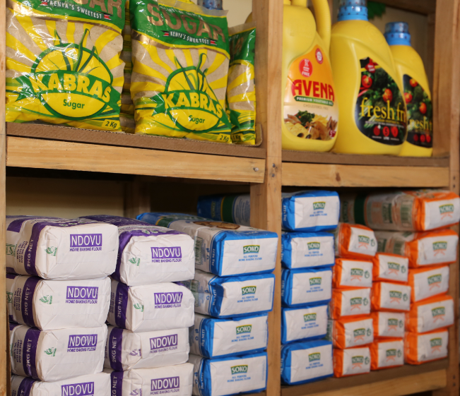 Micro-retailers in Kenya learn how to neatly display their products on shelves.