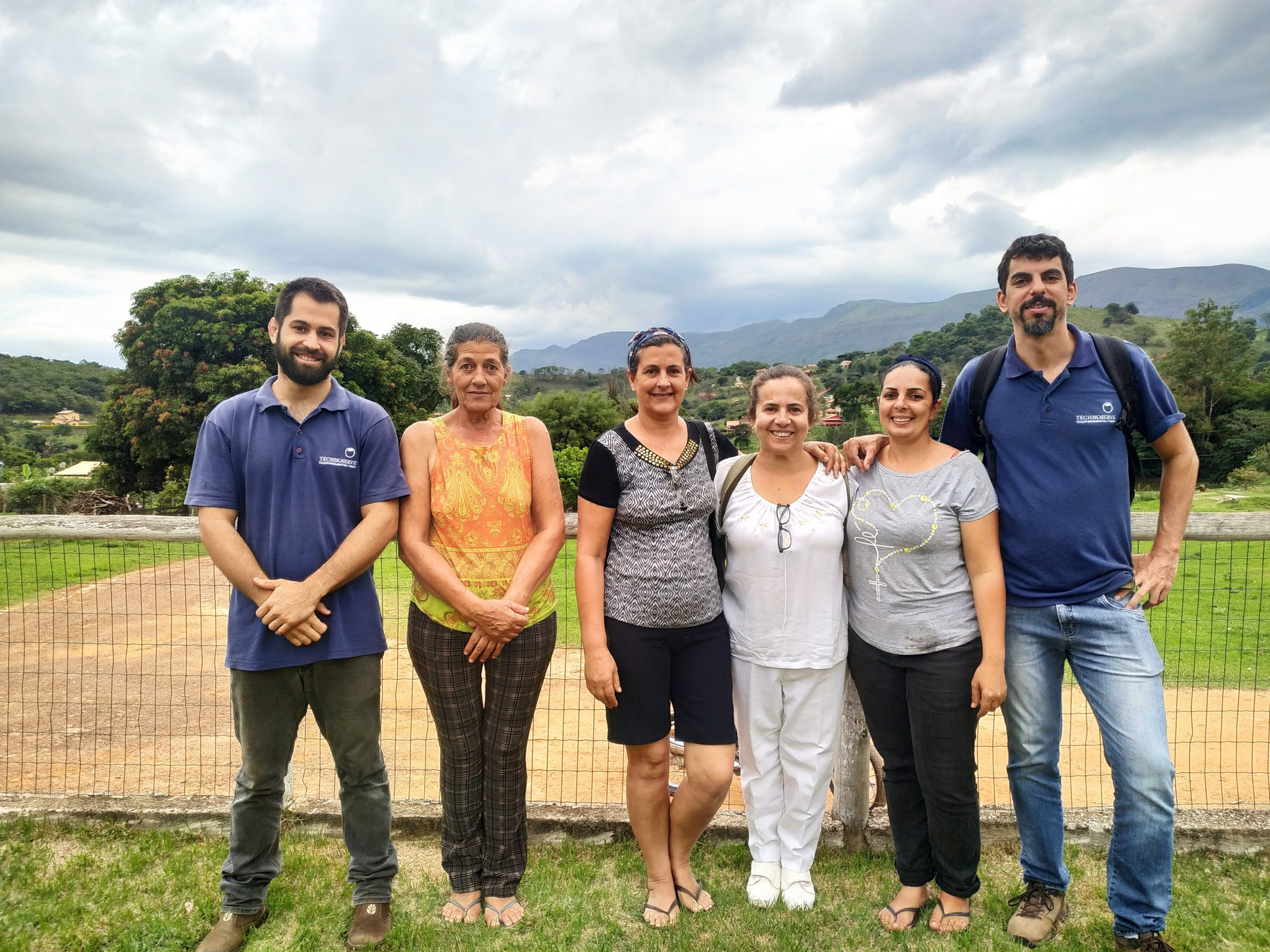 The women who started Talento do Campo stand with two TechnoServe advisors.