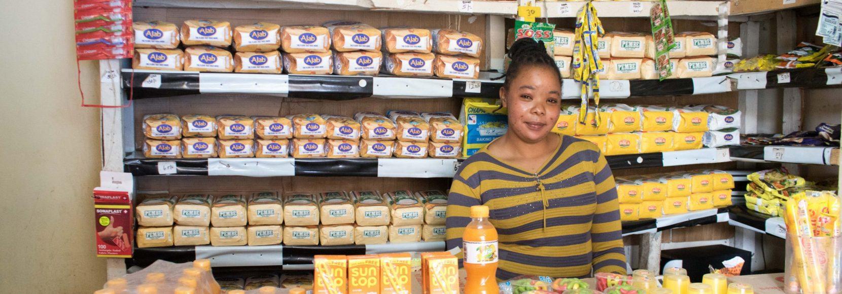 Jacinta Musyoka stands in her micro-retail shop in Nairobi, Kenya