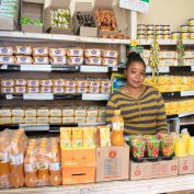 Jacinta Musyoka stands in her micro-retail shop in Nairobi, Kenya