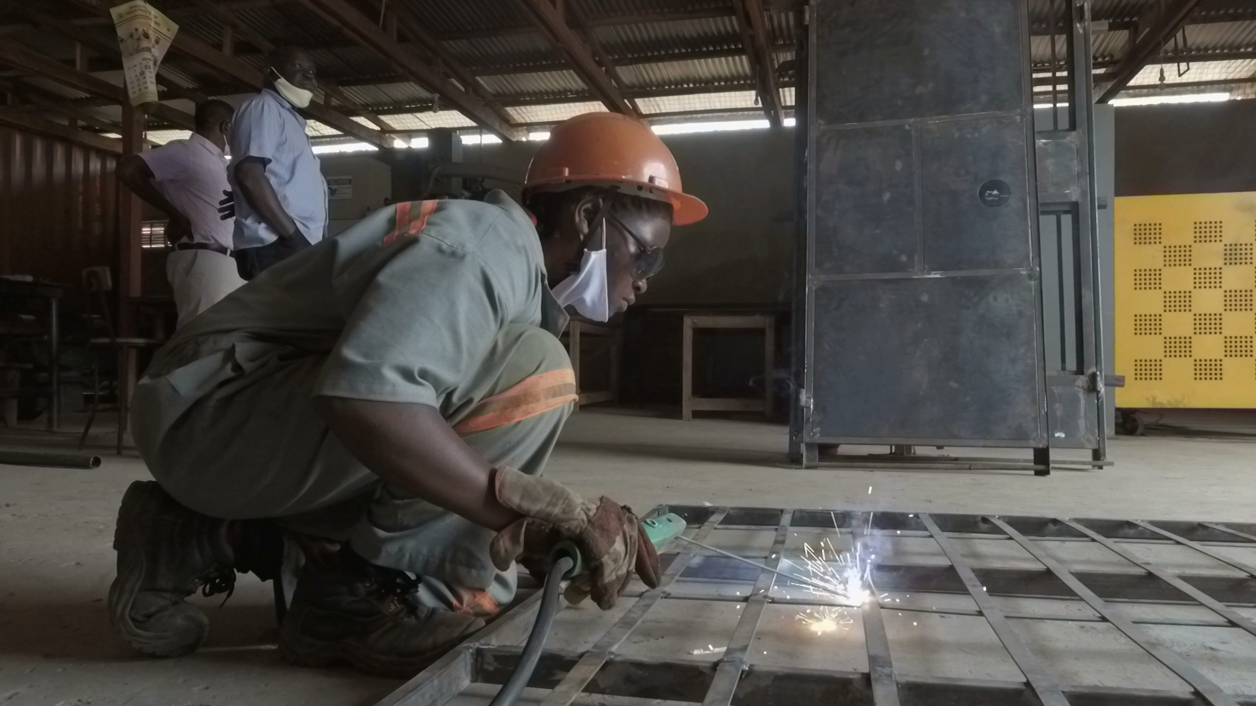 A young person welds near Kampala, Uganda