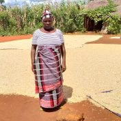 Jacinta Fernando is one of many farmers in northern Mozambique dealing with multiple crises at once. In this photo, she stands in front of her soy harvest.