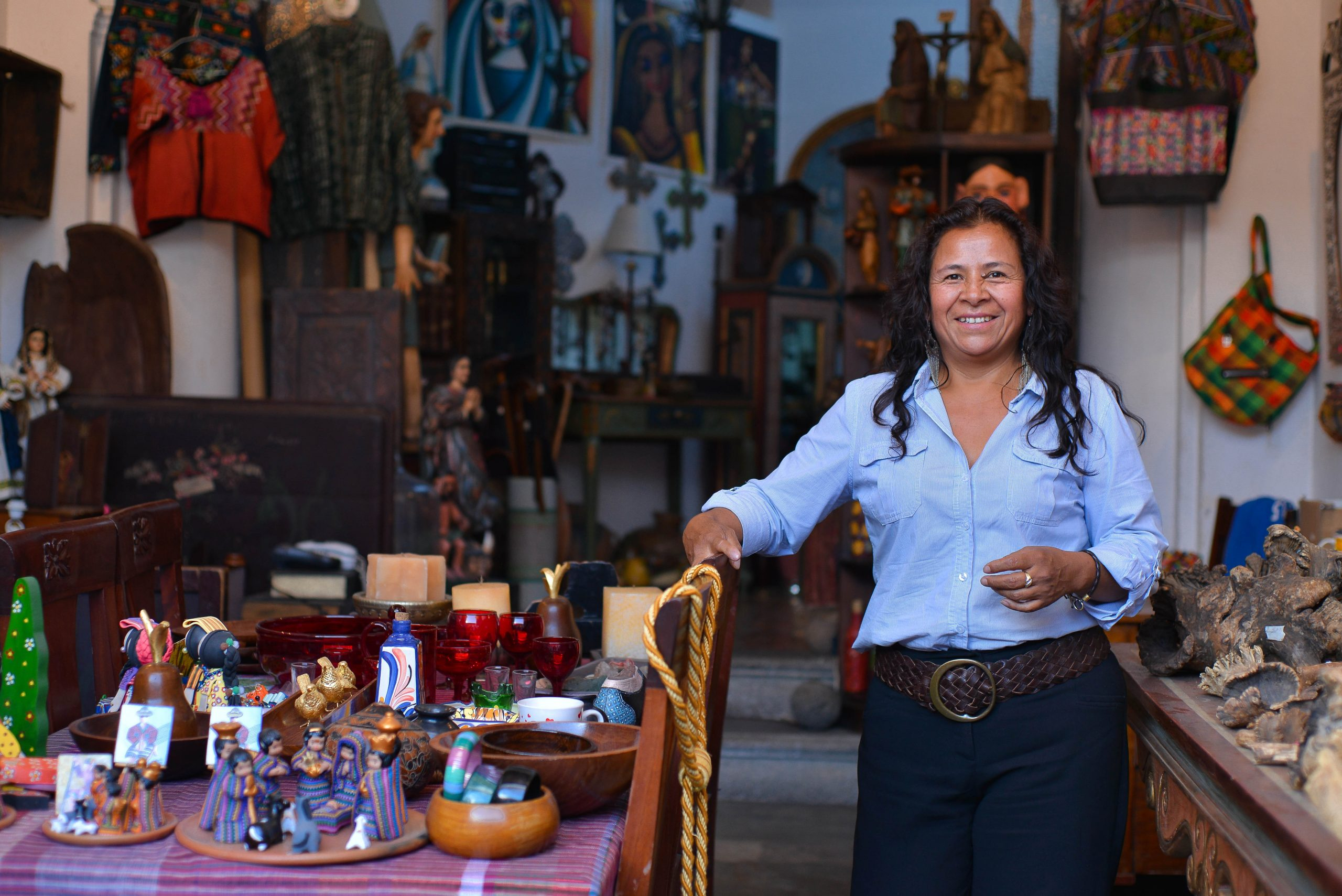 COVID-19 accelerates digitalization in low-income countries. In this photo, a small business owner in Latin America stands in her shop.