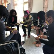 A group of volunteer students attend life skills training in Maputo.