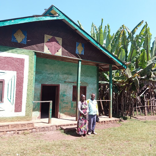 Amanuel is a coffee farmer dedicated to elevating his community, seen here with his wife, Zewditu, in front of their home