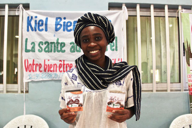 A BeniBiz program participant displays her products in Benin