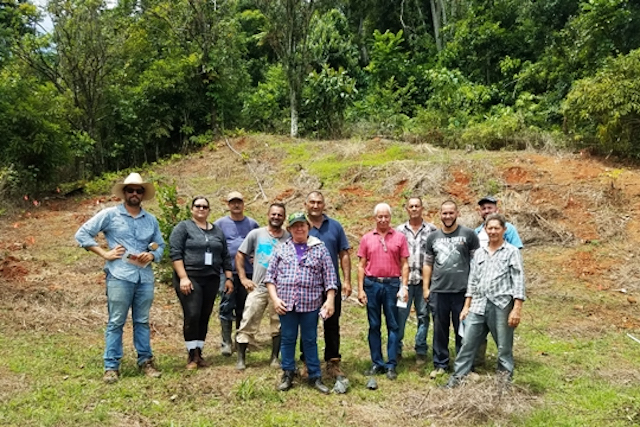 A farmer trainer with a group of farmers in Puerto Rico