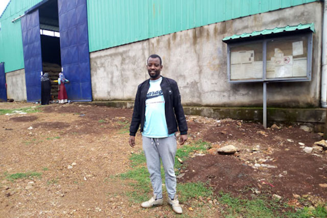 Muhdin Mohammed in front of his coffee hulling station
