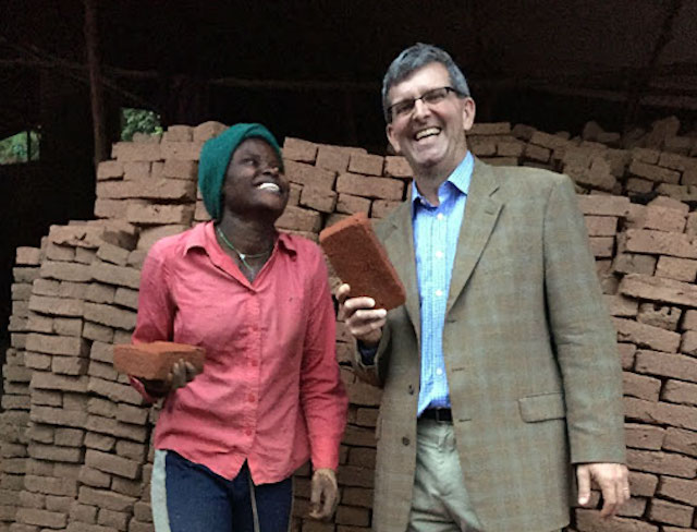 TechnoServe President William Warshauer with Gloriose in northern Rwanda, November 2015.
