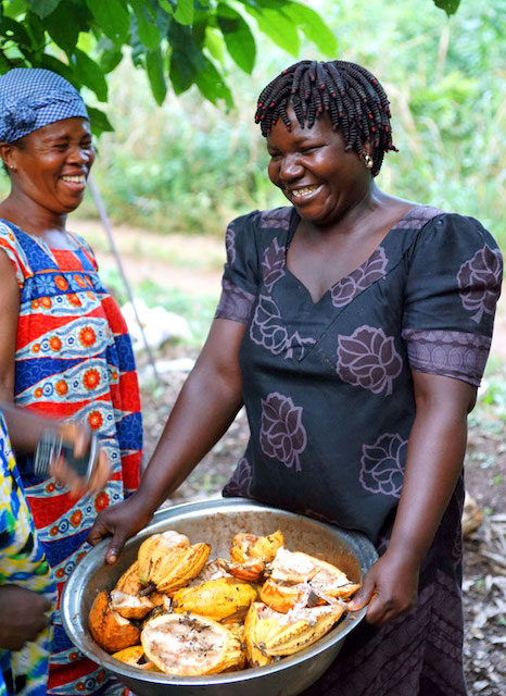 Women farmer chatting with locals in Ghana