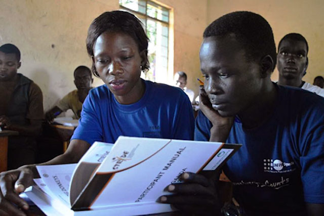 Young students learning the basics of entrepreneurship in Uganda
