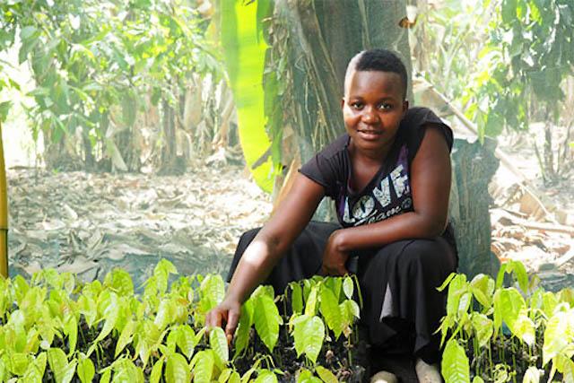 Young entrepreneur Mariam Sanga displaying seedlings in Tanzania
