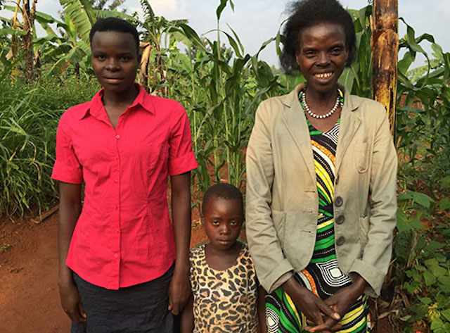Athanasie Musabyimana standing with her children
