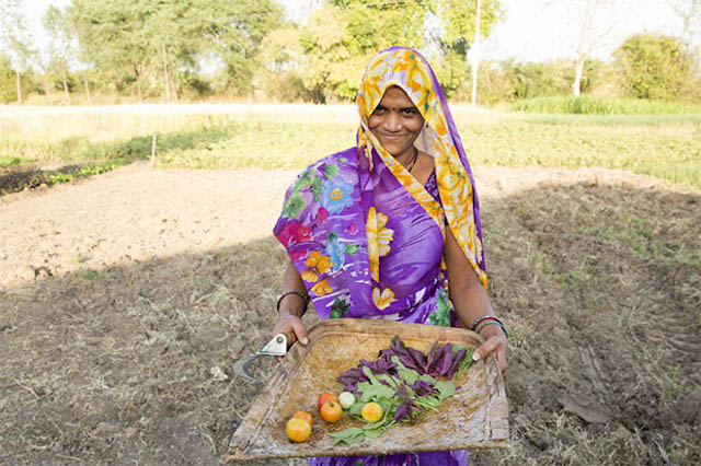 Women farmer displaying freshly picked produce