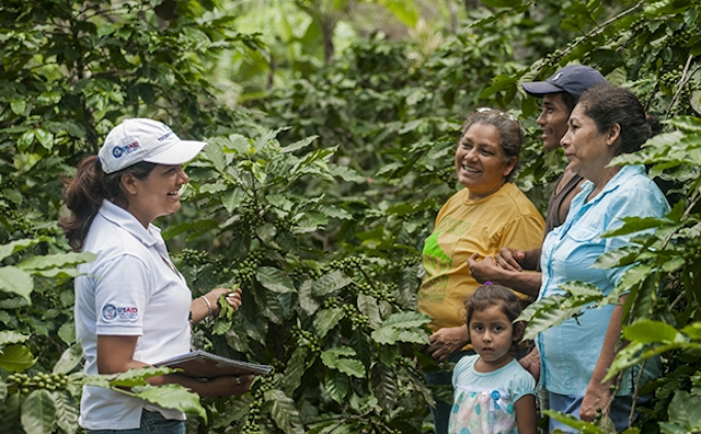 Diana Peralta training coffee farmers in Latin America