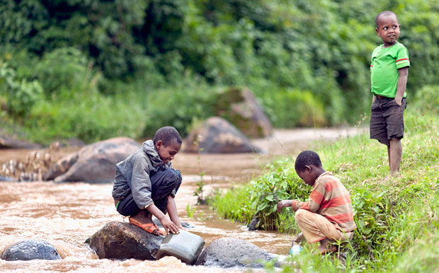 Children from Ethiopia gathering water from a river