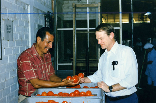 TechnoServe founder Ed Bullard at a tomato processing plant in El Salvador